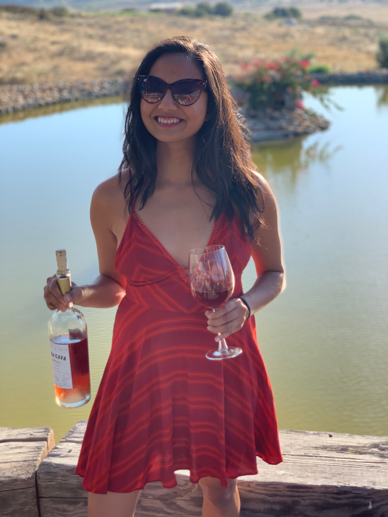 Ligaya Malones holds a glass of wine in Valle de Guadalupe, Baja California, Mexico.