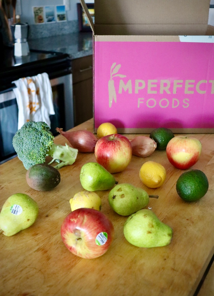 Fruits and vegetables from Imperfect Produce displayed on kitchen island.
